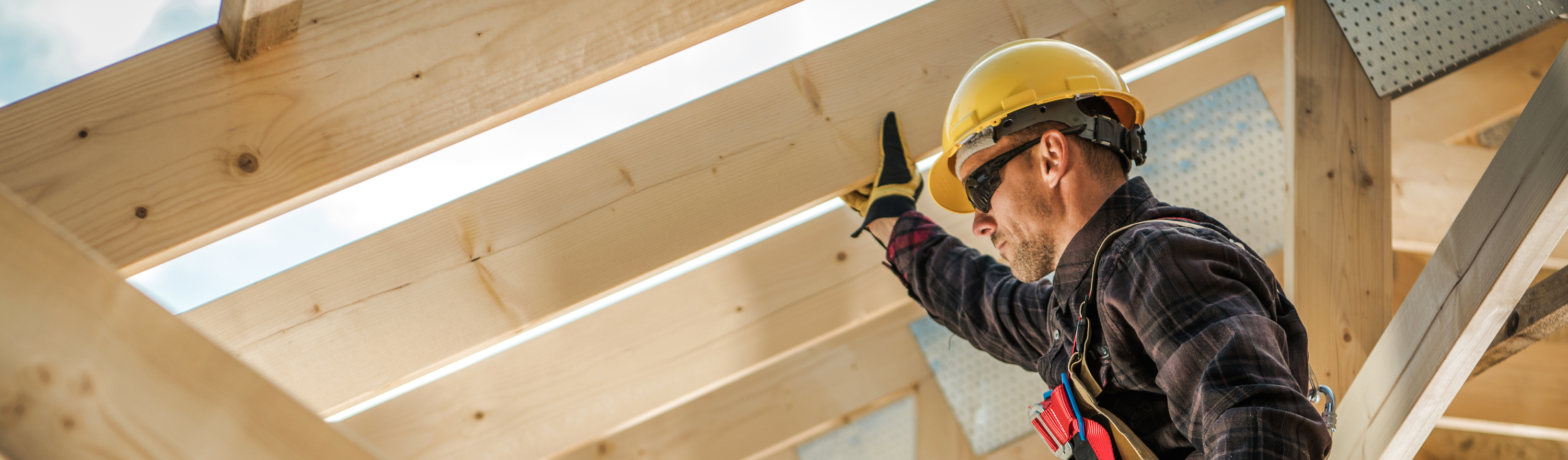 Handyman wearing hard hat fixing rafters of roof needs Tax Relief USA